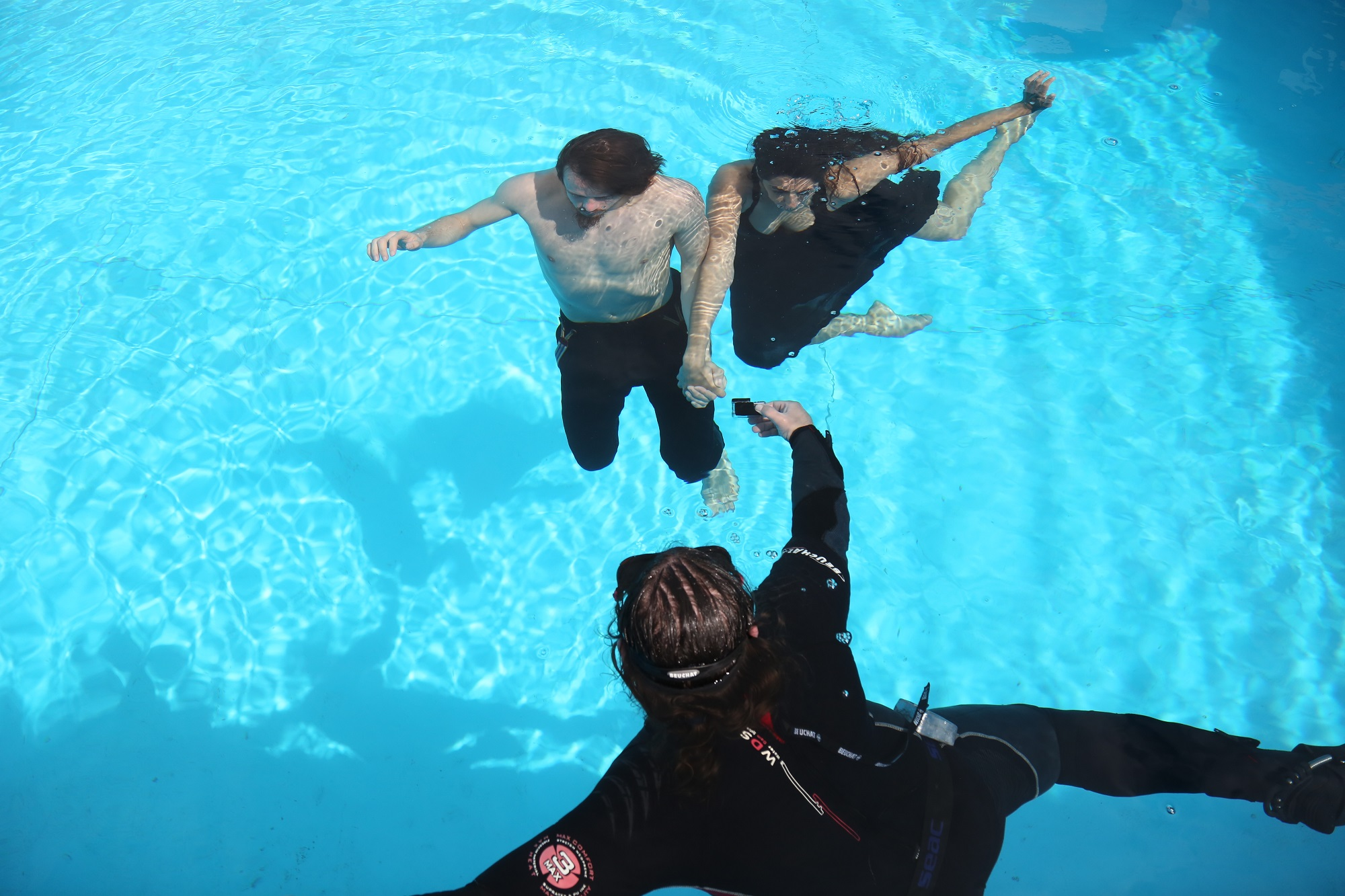 Dancers Gabin Corredor and Zoe Camilleri and underwater camera operator Steve Muscat filming at the National Pool Complex last winter.
