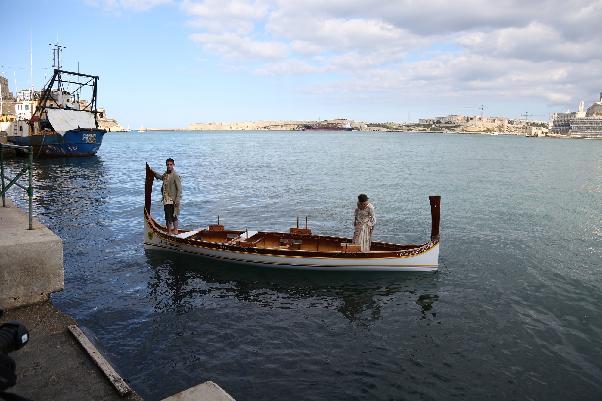 "Niels Plotard and Caroline Mougenot, partners in life and in dance, on set for ""A Maltese Boat and an Admiral"" in the Grand Harbour."